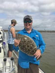 Fisherman with flounder caught on a Galveston Jetty Fishing Trip