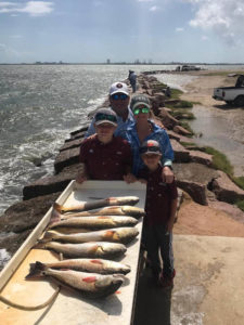 Family's limit of Redfish caught on a Galveston Jetty Fishing Trip